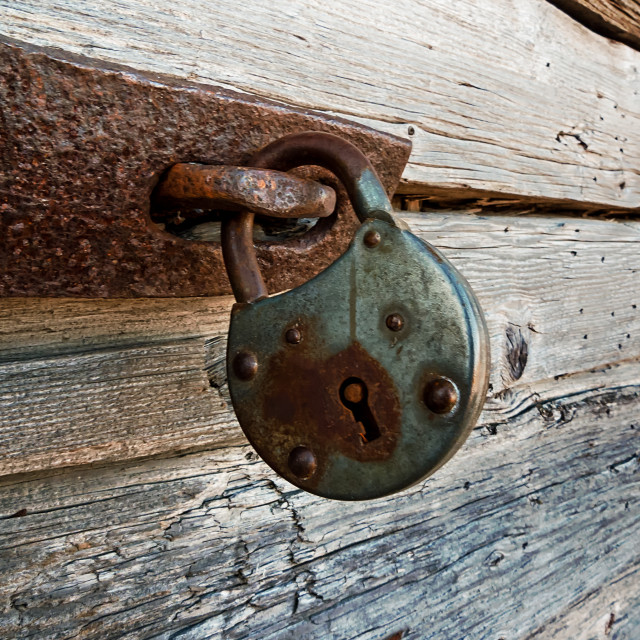 """Old Lock On A Wooden Door"" stock image"