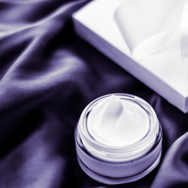 """Luxury moisturizing face cream with lavender scent on violet silk, skincare..."" stock image"