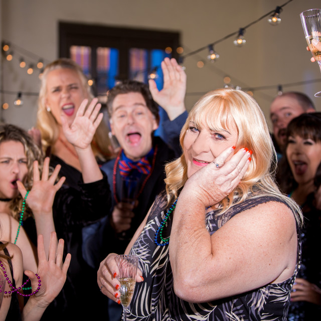 """Trans Woman with Friends at a Party"" stock image"