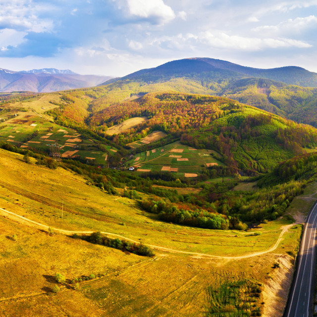 """""""Road in mountains. Evening sunlight on hills."""" stock image"""