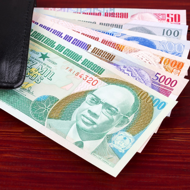 """Money from Guinea Bissau in the black wallet"" stock image"