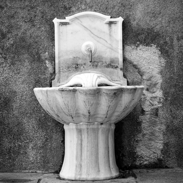 """""""Old drinking water fountain. Black and white photo"""" stock image"""