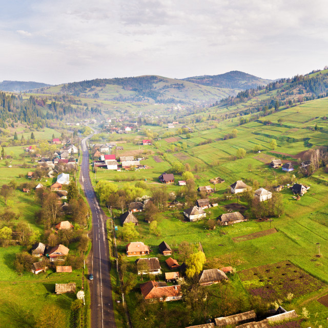 """""""Road in mountain village. Aerial Panorama of Carpathian valley."""" stock image"""