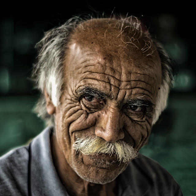 """""""Partially bold old Cypriot Greek man with a big white moustache smiling in a coffee shop"""" stock image"""