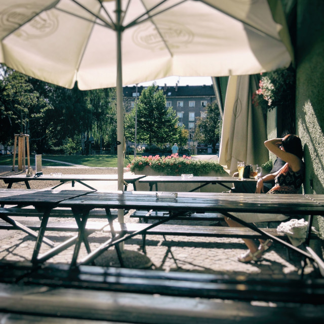 """""""Woman Sitting at an Outdoor Cafe"""" stock image"""