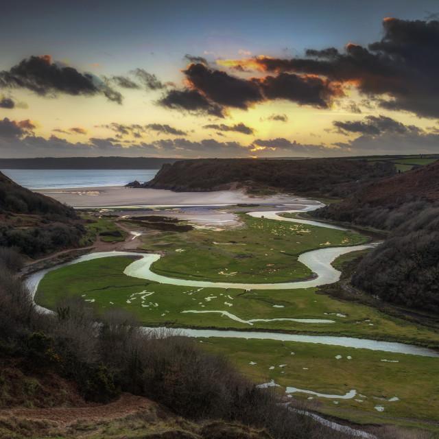 """Sunset at Three Cliffs Bay"" stock image"