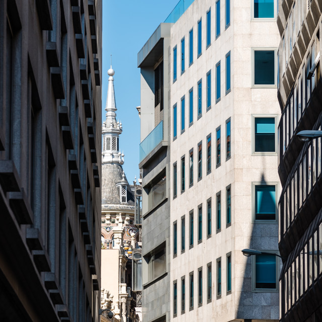 """""""Low angle view of narrow street in historic center of Madrid"""" stock image"""