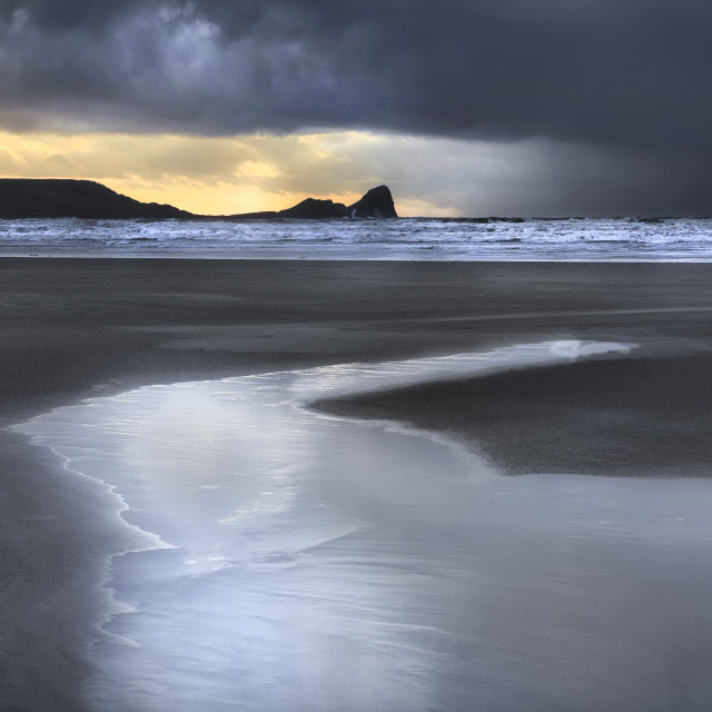 """Dusk at Worms Head and Rhossili Bay"" stock image"