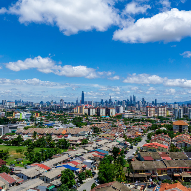 """""""A clear and windy day in Kuala Lumpur, capital of Malaysia. Its modern skyline is dominated by the 451m tall KLCC, a pair of glass and steel clad skyscrapers."""" stock image"""