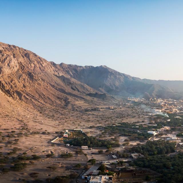 """Sunset over the rock desert in Ras Khaimah emirate in UAE aerial"" stock image"