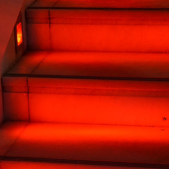 """""""Abstract modern red stairs with warm light - stairway composition"""" stock image"""