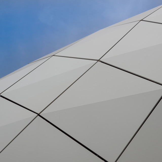 """""""Detail of a circular facade of a modern building made of sandwich panels on..."""" stock image"""