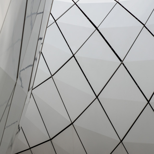 """""""Detail of a circular facade of a modern building made of sandwich panels ."""" stock image"""