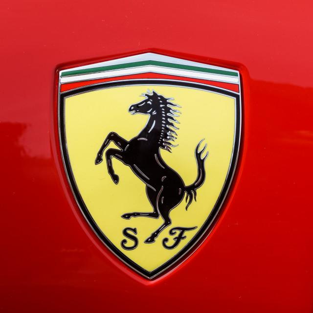 """TURIN, ITALY - JUNE 10, 2017: Classic Ferrari logo on a red car body"" stock image"