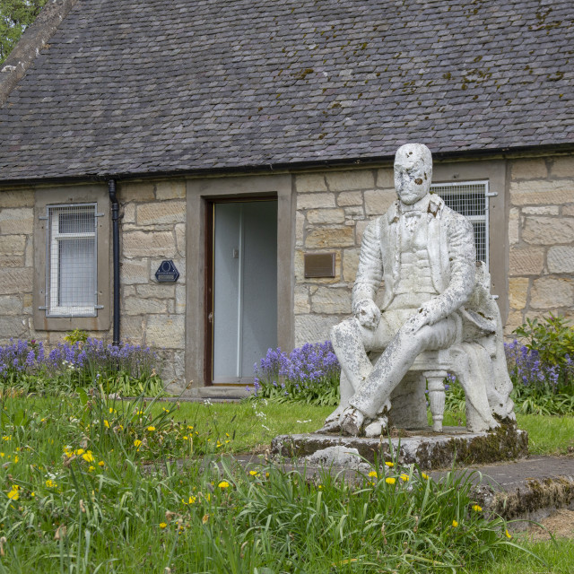 """Sir Walter Scott statue outside an old cottage"" stock image"