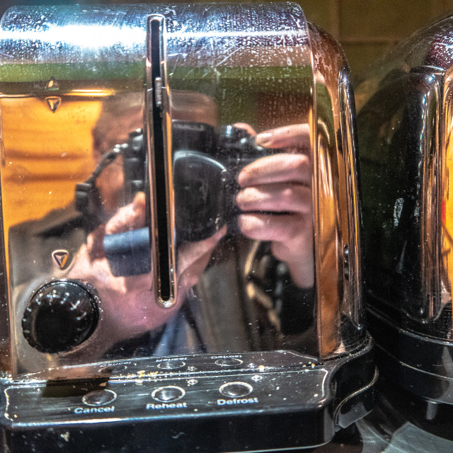 """""""Reflections of the photographer in a shiny toaster"""" stock image"""