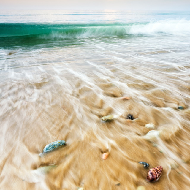 """Rainbow stones on the beach"" stock image"