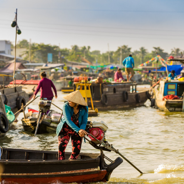 """""""Sailing through the floating market outside of Can Tho, Vietnam"""" stock image"""