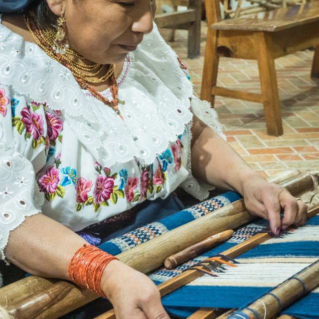 """Indigenous woman weaving with backstrap loom, Otavalo, Ecuador, South America"" stock image"