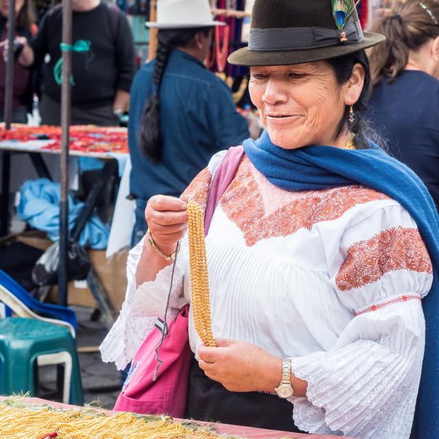 """""""Indiginous woman buying gold necklace, market, Plaza de los Ponchos, Otavalo,..."""" stock image"""