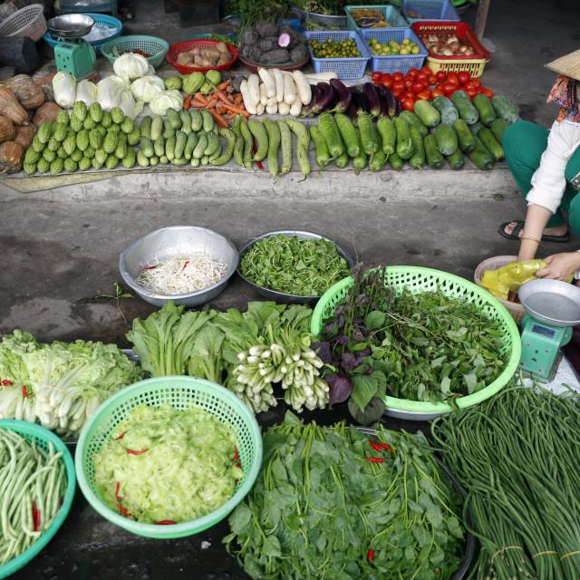 """Vietnamese woman selling vegetables at market. Vung Tau. Vietnam."" stock image"