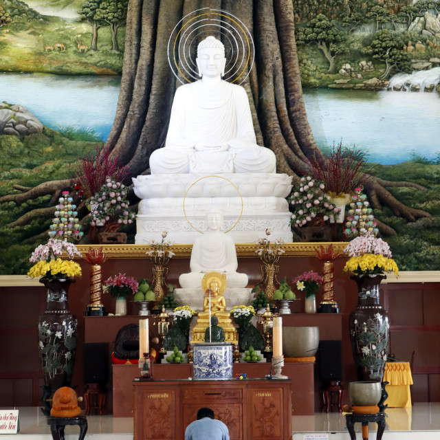 """Van Linh buddhist pagoda. Man praying the Buddha. The Enlightenment of the..."" stock image"