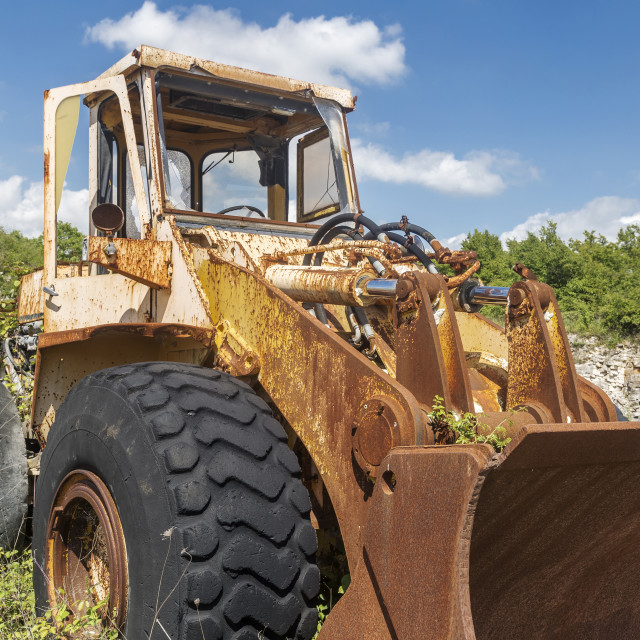 """Yellow cracked excavator"" stock image"