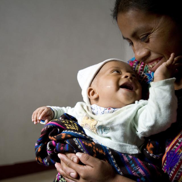"""Maya indigenous mother and child in Panajachel, Solola, Guatemala."" stock image"