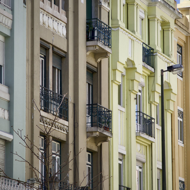 """Coloured Portuguese city buildings"" stock image"