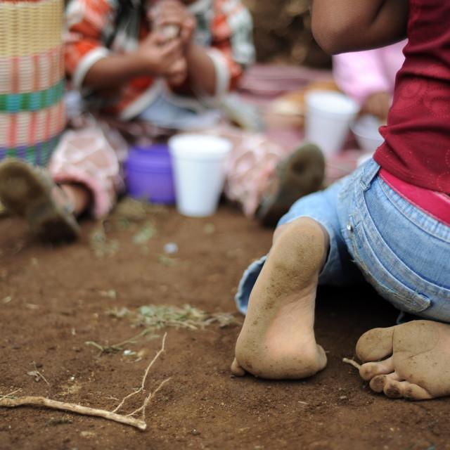 """Maya indigenous girl in bare feet in Aqua Escondida, Solola, Guatemala."" stock image"