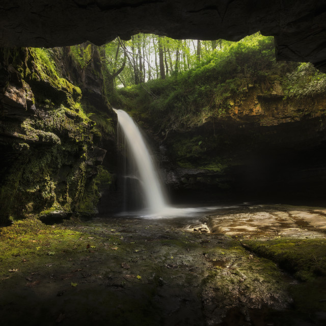 """""""A cave with a waterfall"""" stock image"""