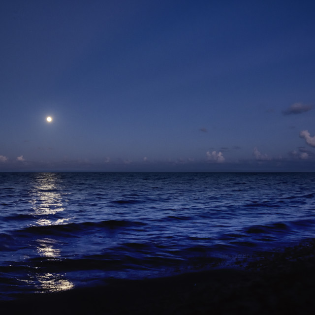 """Moonrise over the Caribbean sea"" stock image"
