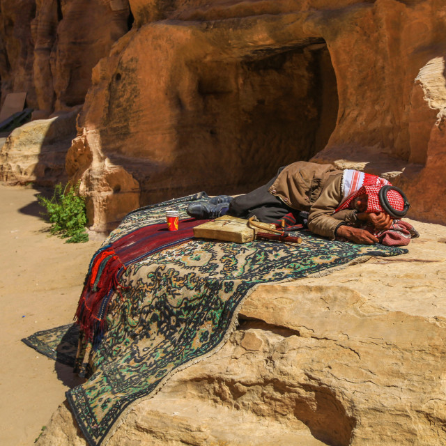 """Bedouin man sleeping (Little Petra)"" stock image"