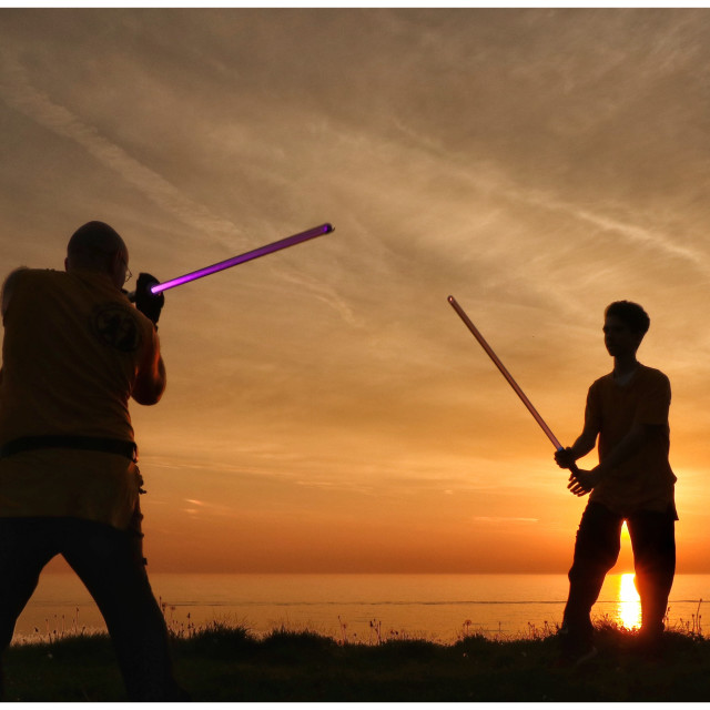 """Lightsabers at sunset"" stock image"