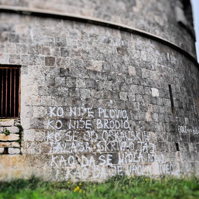 """Fortress Window with Graffiti"" stock image"