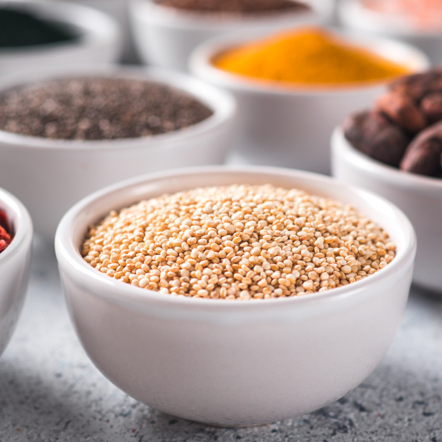 """Quinoa grain in small white bowl and other superfoods"" stock image"