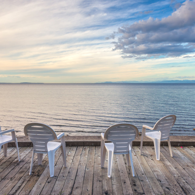 """""""Oceanside seating on a dock"""" stock image"""