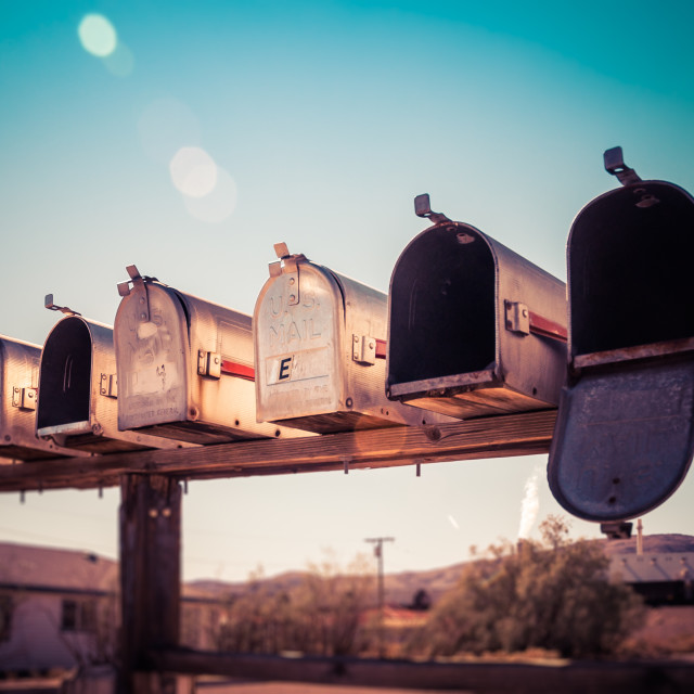 """Rural metal mail boxes in the sun"" stock image"