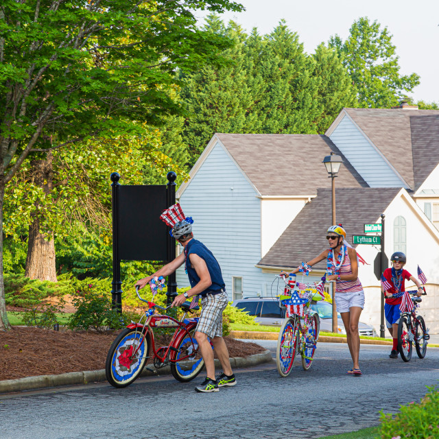 """Family Cycling to Fourth of July Parade"" stock image"