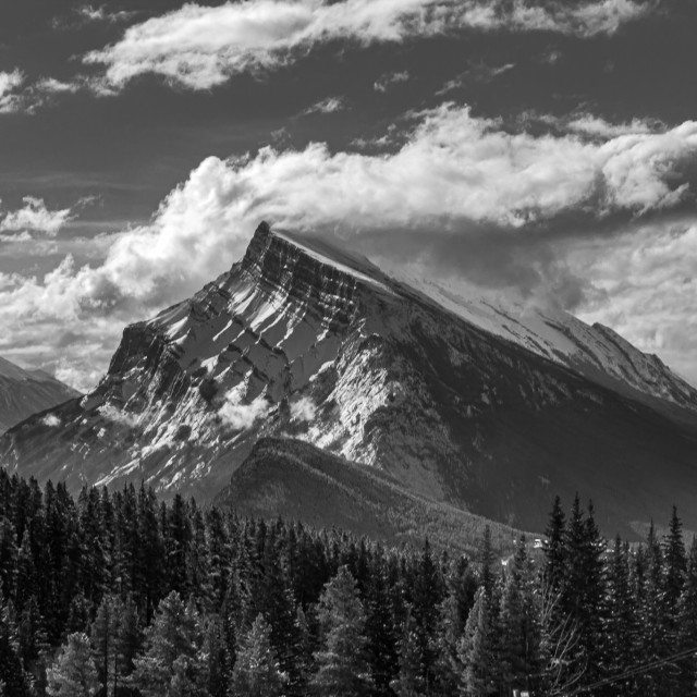 """""""Mount Rundle cutting clouds"""" stock image"""