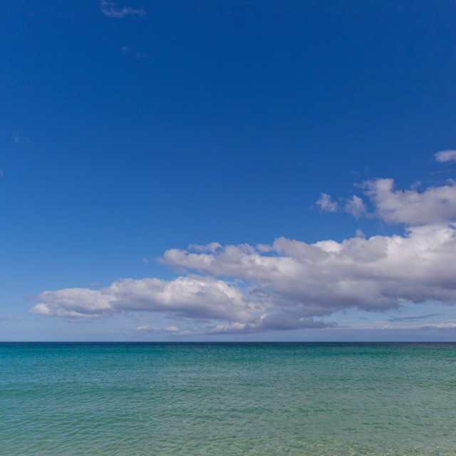 """""""Turquoise sea, blue sky, white clouds"""" stock image"""