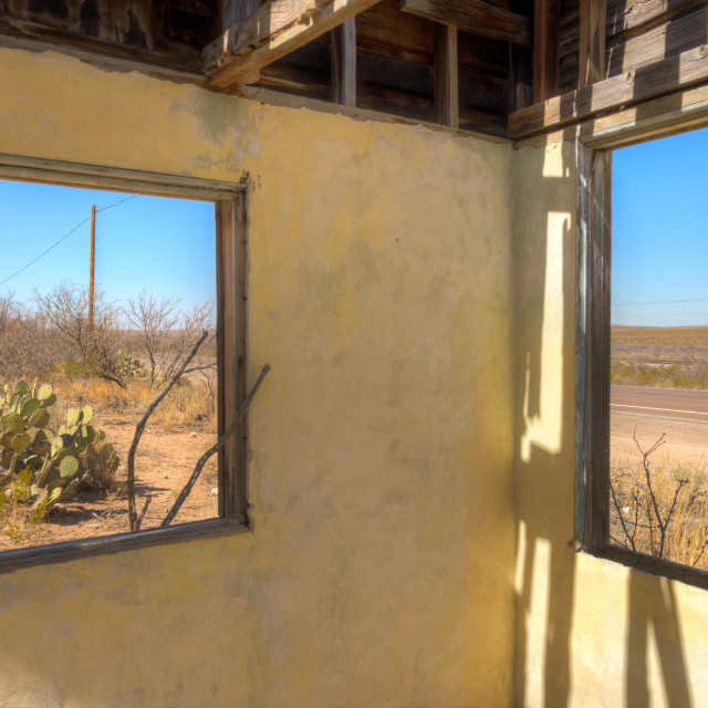 """View through a broken window of an abandoned house."" stock image"