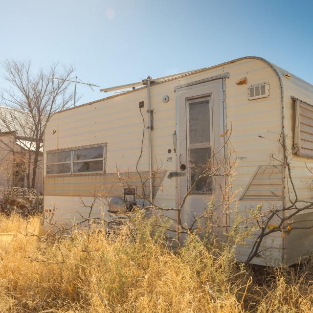 """""""Abandoned retro travel trailer"""" stock image"""