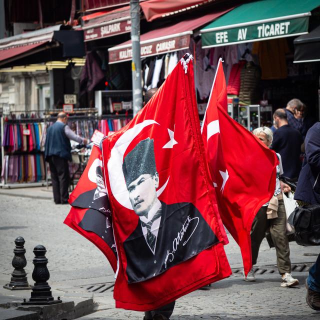 """Turkish Flag picturing Ataturk being sold on street corner"" stock image"