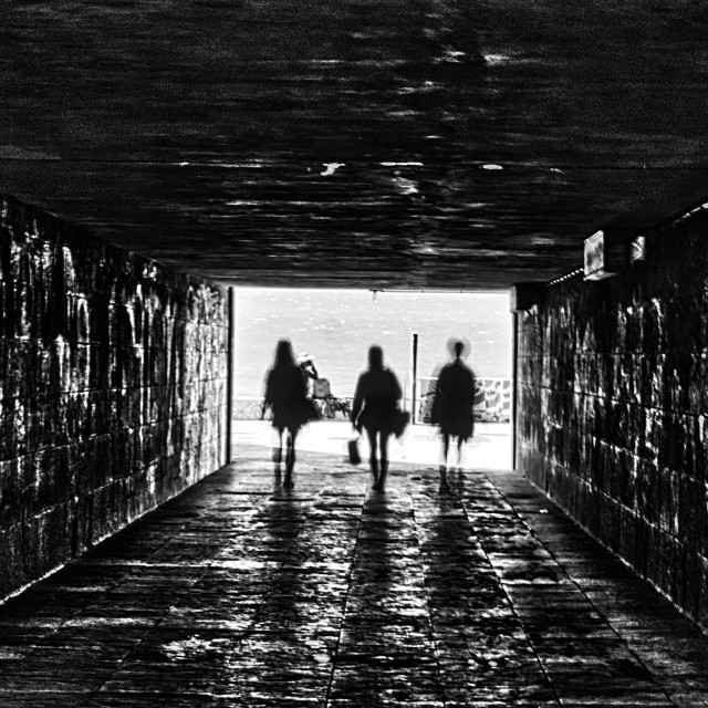 """""""People walking on the tunnel shadows and silhouettes"""" stock image"""