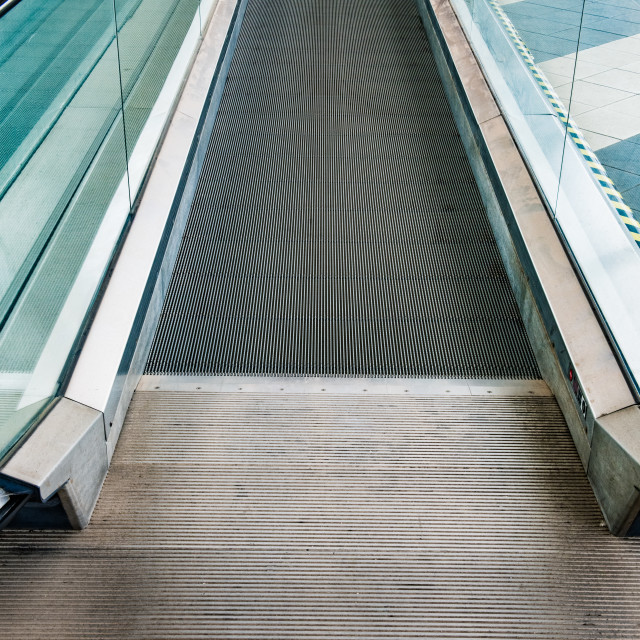"""Empty mechanical escalator pedestrian path"" stock image"