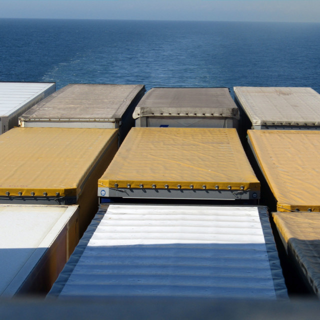 """Coloured freight containers at sea"" stock image"