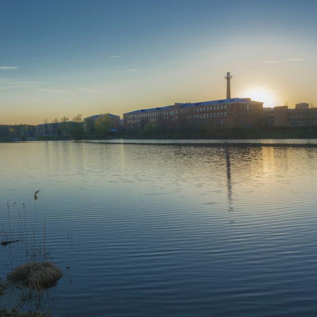 """Sunset on Lake Knazal on the background of a large old weaving f"" stock image"