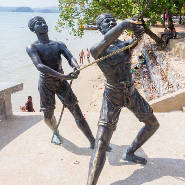 """Public sculpture of fishermen landing a sailfish at Ao Nang beach, Krabi,..."" stock image"