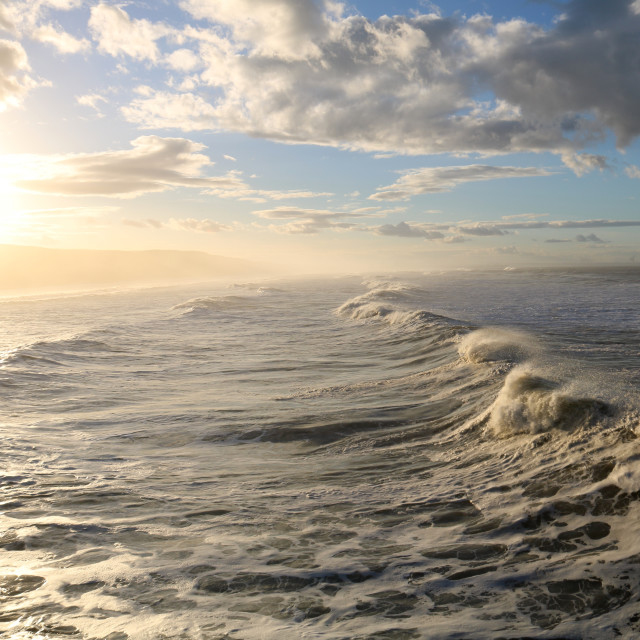 """""""Sunset, clouds & waves."""" stock image"""